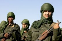 epa01351137 Sahrawi women soldiers look on during a parade in Tifariti ( in the liberated territories of Western Sahara ) on 20 May 2008. The parade marks the 35th anniversary of the Polisario Front and the outbreak of the armed struggle for Western Sahara's independence. The Polisario Front launched on May 20th, 1973, ten days after its creation, the armed struggle against Spanish occupation of Western Sahara, then against the Moroccan army which invaded the territory in October 1975, following Spain's withdrawal. EPA/MOHAMED MESSARA
